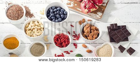 Super Foods On A White Wooden Board.