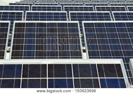 Many alternative electricity generating energy solar panels on roof