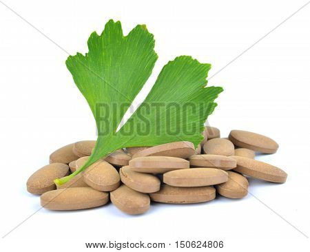 Ginkgo Biloba leaf with pills isolated on white background