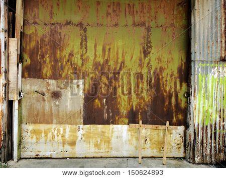 old rusty industrial garage door. background texture
