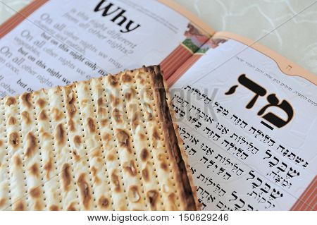 Traditional Jewish Matzo sheets on a Passover Seder table. Passover is a Jewish holiday festival. It commemorates the Exodus from Egypt in which the ancient Israelites were freed from slavery.
