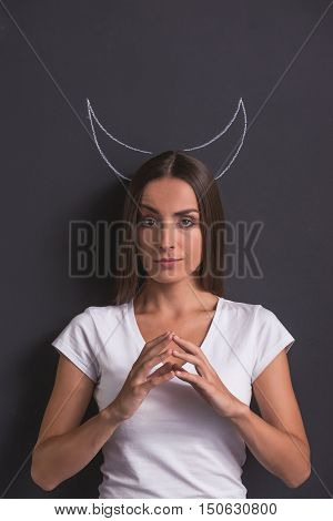 Girl Showing Devil