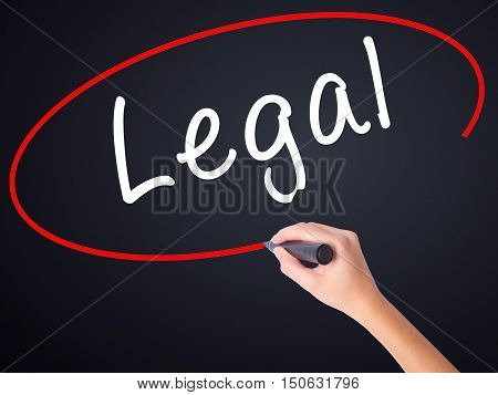 Woman Hand Writing Legal With A Marker Over Transparent Board