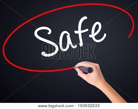 Woman Hand Writing Safe With A Marker Over Transparent Board