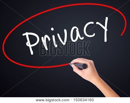 Woman Hand Writing Privacy With A Marker Over Transparent Board