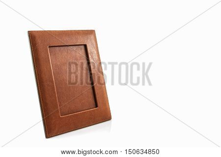 Vintage leather picture frame on white background.