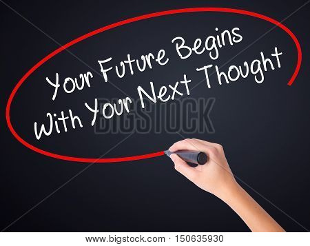 Woman Hand Writing Your Future Begins With Your Next Thought With A Marker Over Transparent Board .