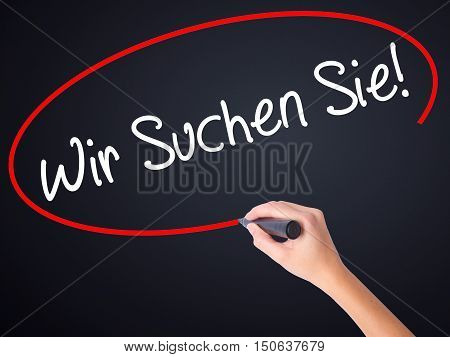 Woman Hand Writing Wir Suchen Sie! (looking For You In German) With A Marker Over Transparent Board