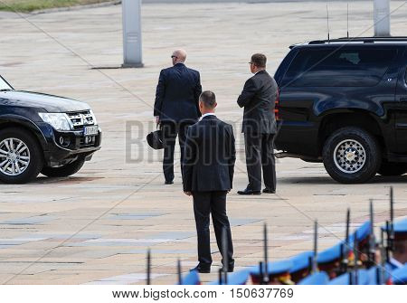 BELGRADE, SERBIA - AUGUST 16th, 2016: Security officers protects car with VIP person, on August 16th in Belgrade