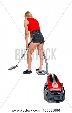 Rear view of a woman with a vacuum cleaner. She is busy cleaning. Rear view people collection.  backside view of person.  Isolated over white background. The girl in shorts with a vacuum cleaner