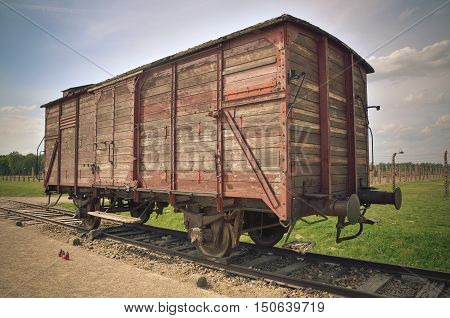 OSWIECIM POLAND - MAY 12 2016: Car train in concentration camp Auschwitz-Birkenau II in Brzezinka Poland. Transport wagon used for deportation to concentration camp.