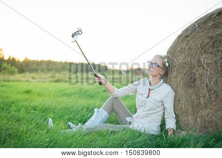 Beautiful Young Woman Making A Selfie On The Grass In The Meadow