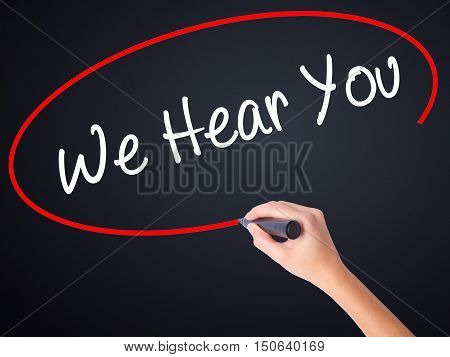 Woman Hand Writing We Hear You With A Marker Over Transparent Board