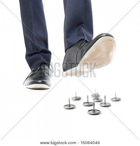 A businessman about to step on needles