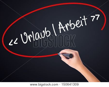 Woman Hand Writing Uralaub Arbeit (vacation - Work In German) With A Marker Over Transparent Board .