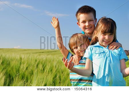 Happy children in cereal field