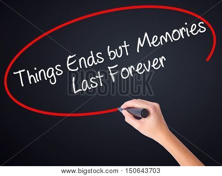 Woman Hand Writing Things Ends But Memories Last Forever With A Marker Over Transparent Board
