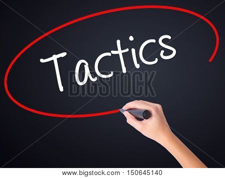 Woman Hand Writing Tactics With A Marker Over Transparent Board .