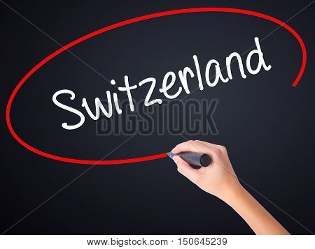 Woman Hand Writing Switzerland  With A Marker Over Transparent Board