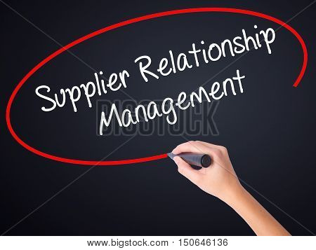 Woman Hand Writing Supplier Relationship Management With A Marker Over Transparent Board .