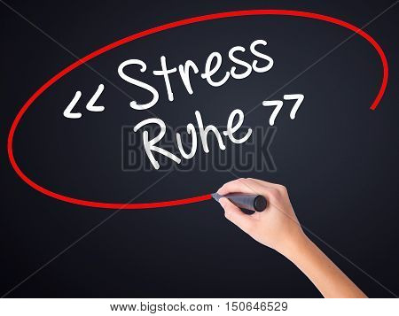 Woman Hand Writing Stress Ruhe  (stress - Peacein German) With A Marker Over Transparent Board .