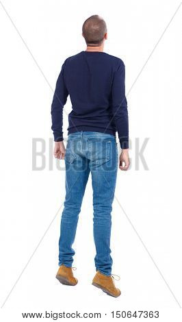 Back view of a curious guy who stood on tiptoes, and peering up. tanding young guy. Rear view people collection.  backside view of person.  Isolated over white background.  Man in warm jacket stood on