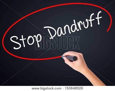 Woman Hand Writing Stop Dandruff With A Marker Over Transparent Board