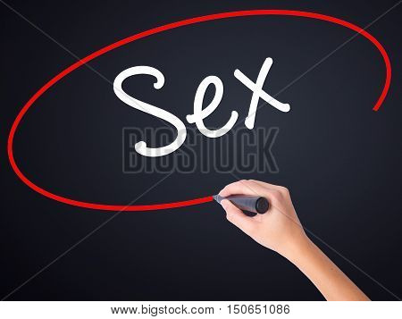 Woman Hand Writing Sex With A Marker Over Transparent Board