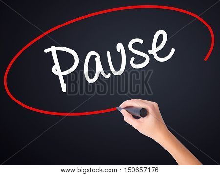 Woman Hand Writing Pause With A Marker Over Transparent Board