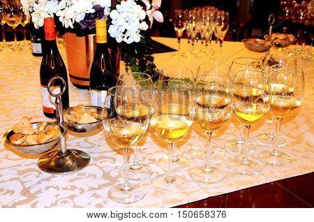 Underground wine sampling hall on October 02 2016. The wine cellars of Cricova is second largest wine cellar in Moldova.Wine tasting wine glasses and bottles of wine