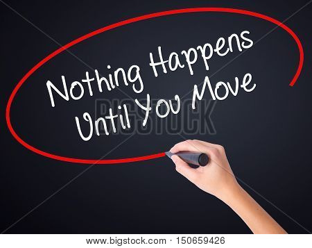 Woman Hand Writing Nothing Happens Until You Move With A Marker Over Transparent Board