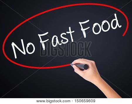 Woman Hand Writing No Fast Food With A Marker Over Transparent Board .