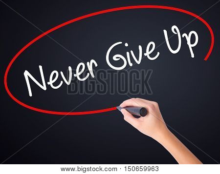 Woman Hand Writing Never Give Up With A Marker Over Transparent Board