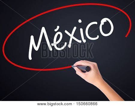 Woman Hand Writing Mexico (in Spanish) With A Marker Over Transparent Board .