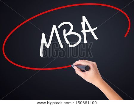 Woman Hand Writing Mba With A Marker Over Transparent Board