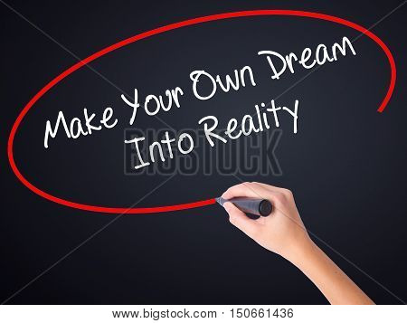 Woman Hand Writing Make Your Own Dream Into Reality With A Marker Over Transparent Board