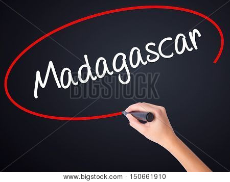 Woman Hand Writing Madagascar With A Marker Over Transparent Board