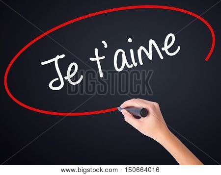 Woman Hand Writing Je T'aime ( I Love You In French)  With A Marker Over Transparent Board