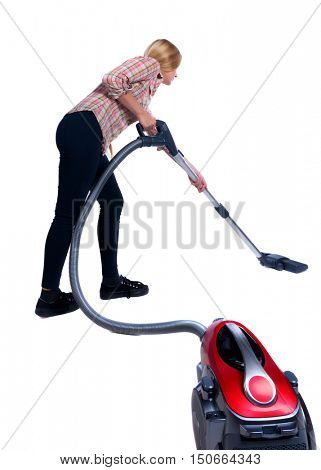 Rear view of a woman with a vacuum cleaner. She is busy cleaning. Rear view people collection.  backside view of person.  Isolated over white background. Long-haired blonde with a red vacuum cleaner.