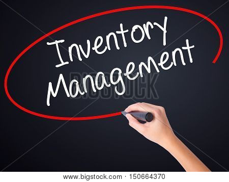 Woman Hand Writing Inventory Management With A Marker Over Transparent Board .