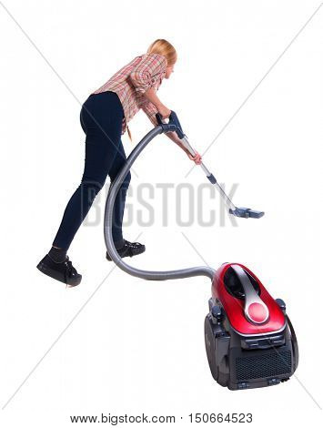 Rear view of a woman with a vacuum cleaner. She is busy cleaning. Rear view people collection.  backside view of person.  Isolated over white background. blonde in a black pants with red vacuum