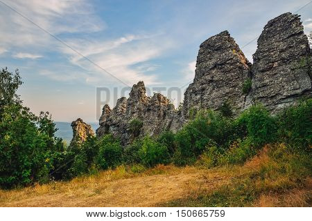 Amazing landscape with mountain range and beautiful blue sky, dragon backbone, Russia, Ural, Europe - Asia boundary.