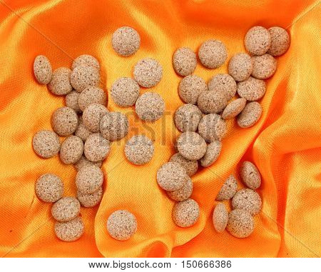 picture of a herb capsules on a luxury fabric background