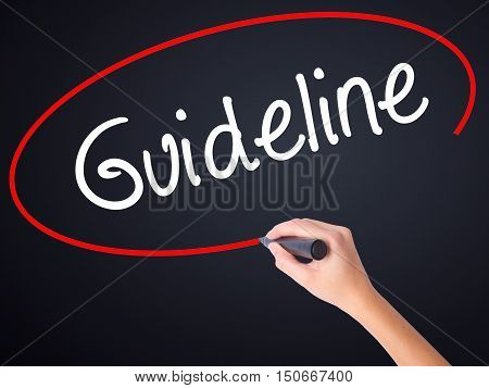 Woman Hand Writing Guideline With A Marker Over Transparent Board