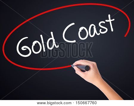 Woman Hand Writing Gold Coast With A Marker Over Transparent Board