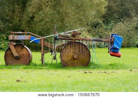 Rugby scrum machine in profile. Old and rusty Rugby scrummage training device on pitch near Bath in Somerset UK