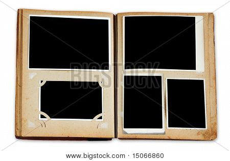 Vintage photo album with empty photos isolated on white background with clipping path