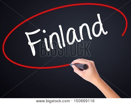 Woman Hand Writing Finland With A Marker Over Transparent Board .