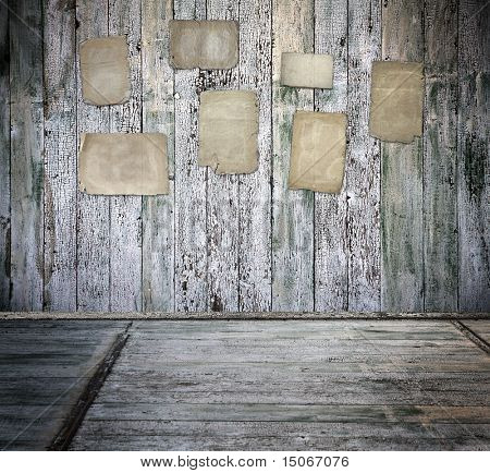 grunge interior with old papers on walls