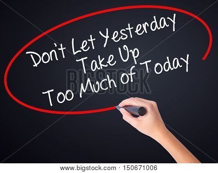 Woman Hand Writing Don't Let Yesterday Take Up Too Much Of Today With A Marker Over Transparent Boar